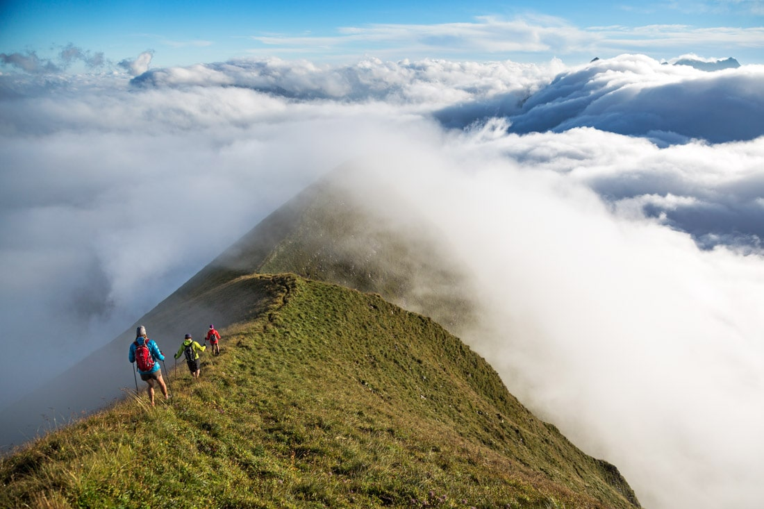Hikers on the Hardergrat, also known as the Brienzergrat, during a traverse of the entire ridge. This ridge is 27km long with 3100 meters of vertical gain, and is a classic one day test piece trail connecting Interlaken to Brienz, Switzerland