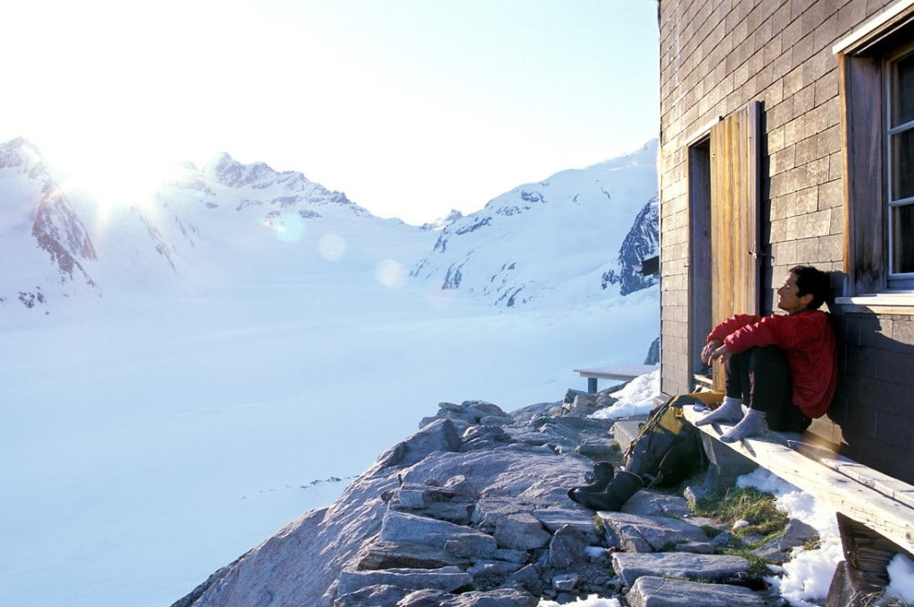 Relaxing on the deck of the Konkordia Hut and looking out to the Aletschgletscher, Europe's largest glacier. Bernese Alps, Switzerland