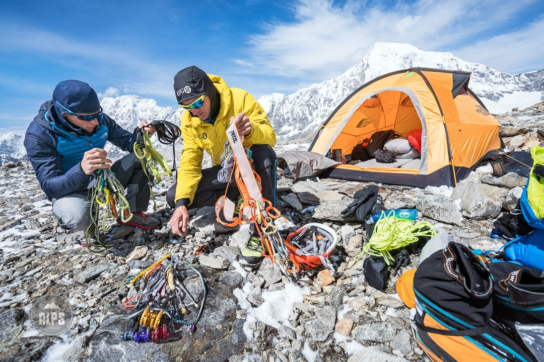 Ueli Steck and David Göttler packing climbing gear