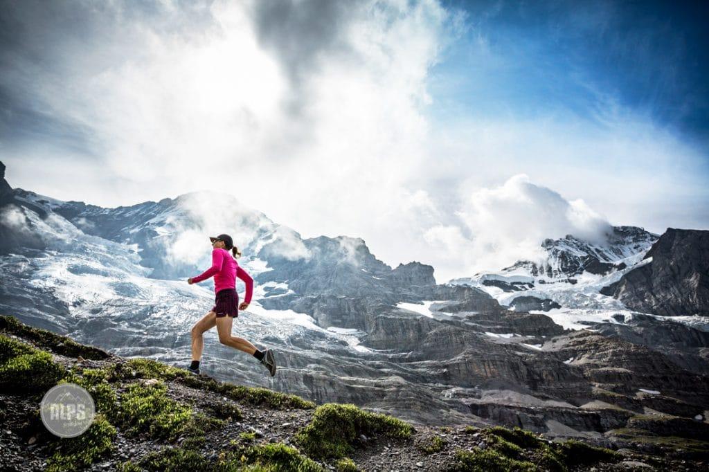 Trail running in the Swiss Alps at Kleine Scheidegg, above Grindelwald, Switzerland in changing weather