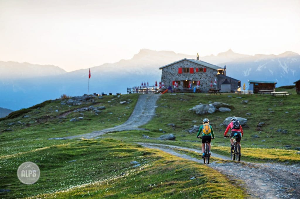 Two women mountain biking up to the Bella Tola Hut while on a mountain bike tour from Bella Tola in the Val d'Anniviers, Switzerland