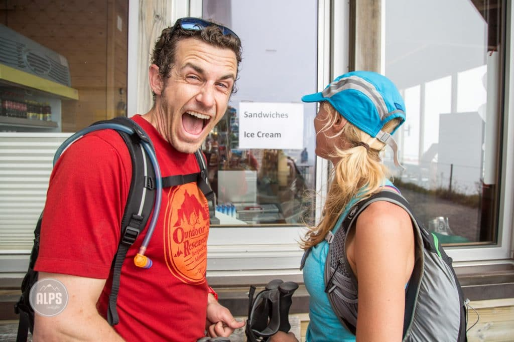 A couple stands at the Brienzer Rothorn restaurant after hiking the entire Hardergrat Trail from Interlaken to Brienz, 27km and 3100 meters of vertical. He is very excited to get some food.