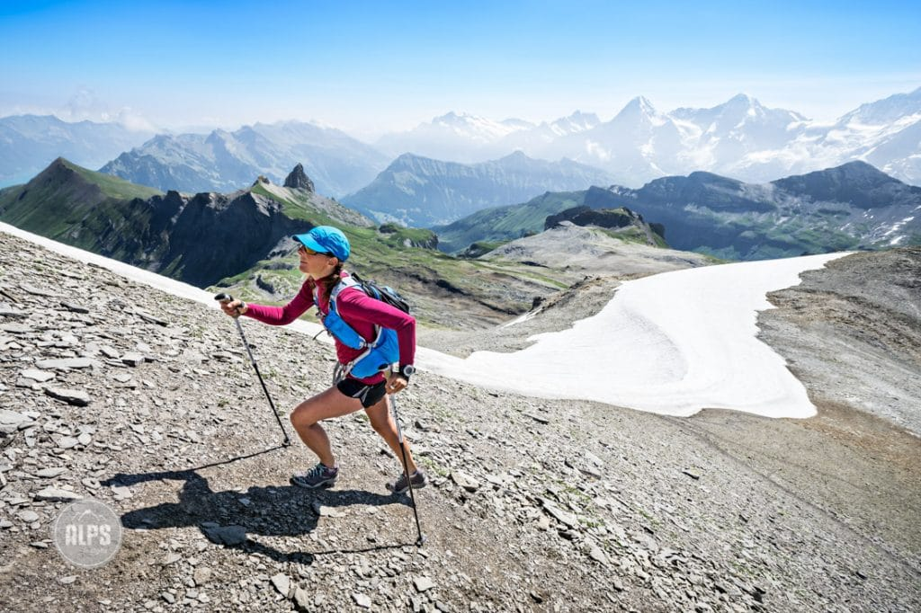 A woman hikes up the steep, rocky landscape to the top of the Schwalmere, one of the highest peaks right outside Interlaken, Switzerland