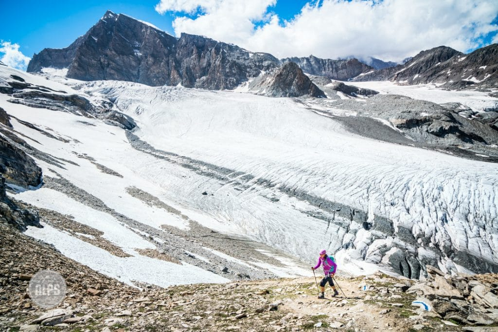 Hiking the Glacier Trail out of Saas Fee, Switzerland. The trail connects Saas Fee with the Mattmark Lake and crosses two glaciers, but is possible without a rope and as a walking trail. In the background is the 4199 meter Rimpfischhorn.
