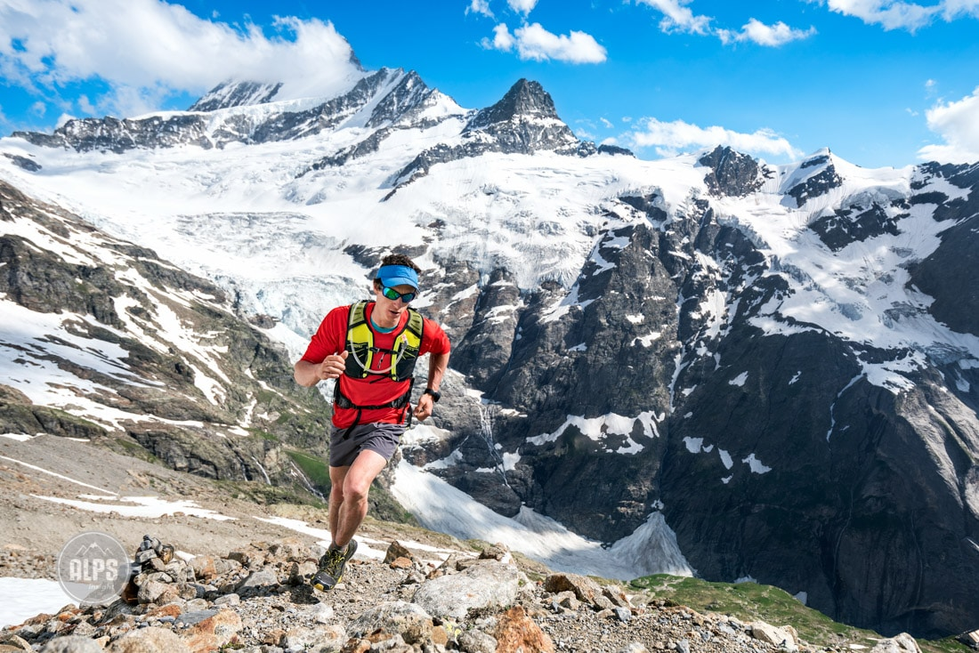 Trail running high in the Swiss Alps, above Grindelwald, Switzerland, with the Schreckhorn in the background