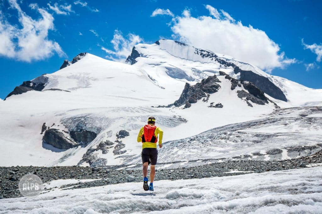 A trail runner on the Glacier Trail from Saas Fee to the Mattmark Lake, Switzerland. In addition to a lot of singletrack, the unique trail crosses two glaciers but is safe enough to do as a run or hike without a rope.