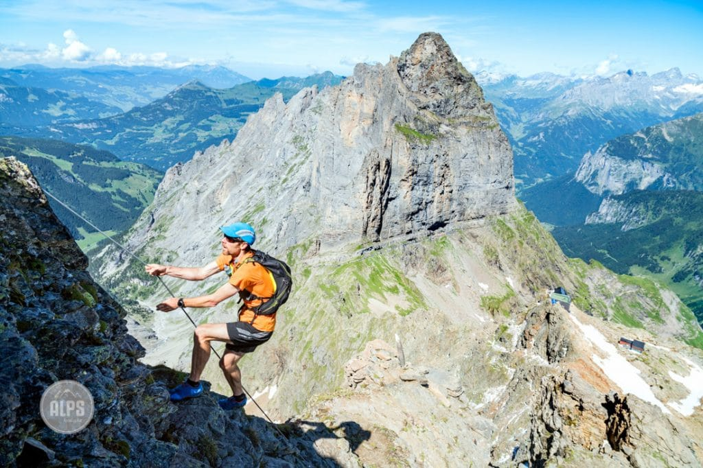 A runner climbing cables on the way to the Dossen Peak from Rosenlaui is on a Swiss Alpineweg, which are steep trails with cables and ladders in place.