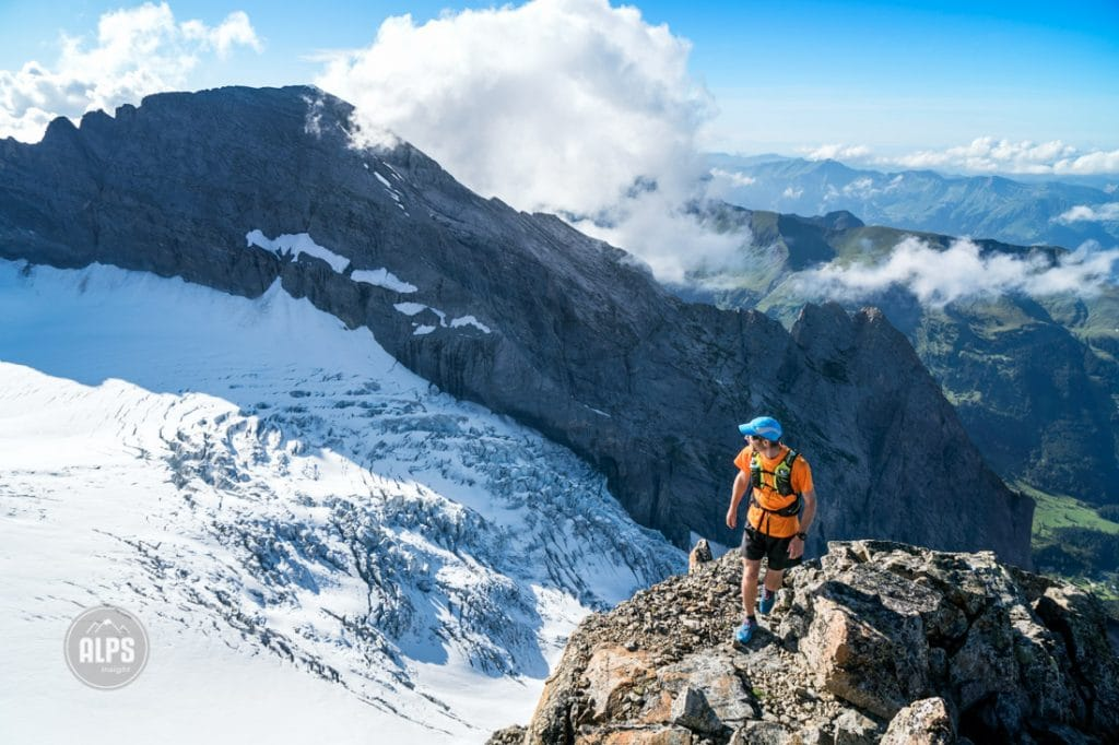 A hiker on the top of the Dossen Peak, after a nearly 2000 meter ascent from Rosenlaui. He is looking out on the glacier below, the Rosenlauigletscher