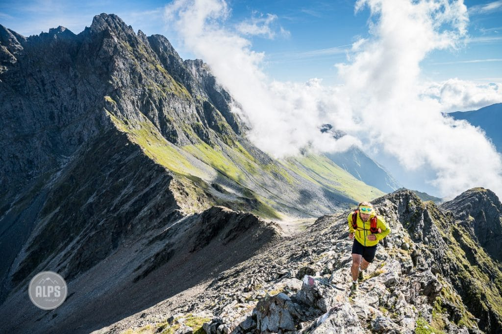 Trail running above Lüsens, Austria while on a multi-day running tour