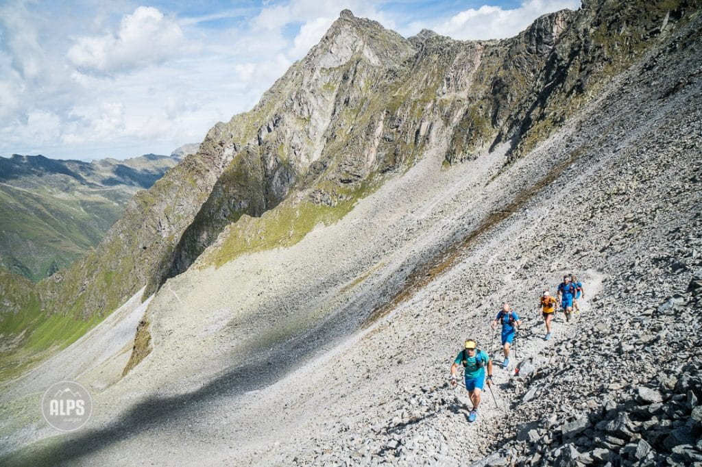 Trail running above the Stubaital, Austria while on a multi-day running tour