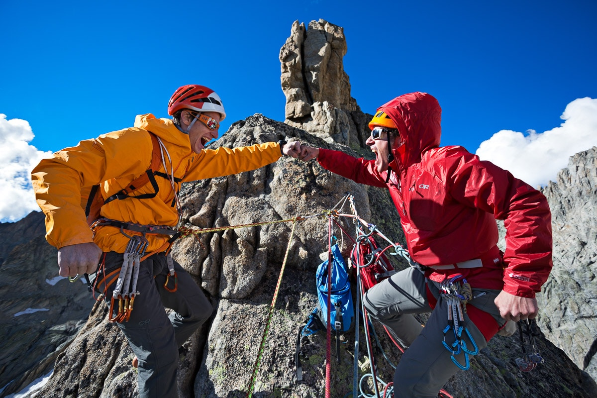 Two climbers joking around before the final pitch of the Aiguille Dibona, Ecrins National Park, France