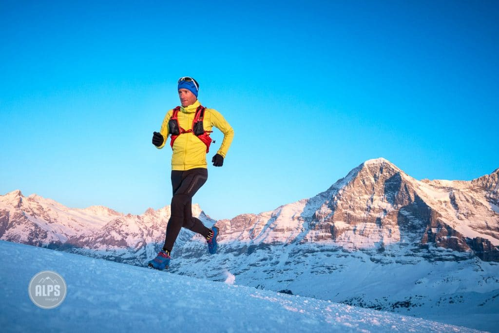 Winter running on snow at Männlichen high above Lauterbrunnen and Grindelwald in the Jungfrau Region of Switzerland. In the background is the North Face of the Eiger.