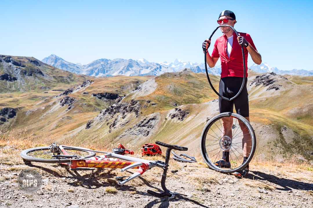 A gravel biking trip and tour to the Sestriere area of Piemonte, Italy. The gravel roads were built for the military and are still used; the Colle delle Finestre and Strada dell'Assietta. With new gravel bikes, the roads are perfect for road bikers seeking off road fun. Fixing a flat tire.