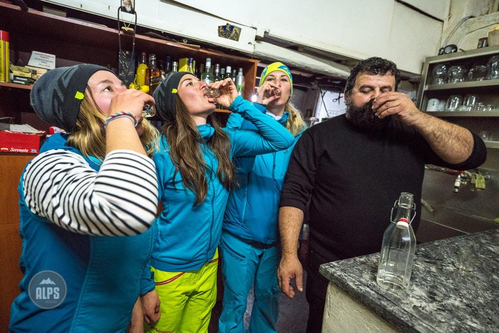 A group of girlfriends drinking raki at a Greek restaurant, Crete, Greece.