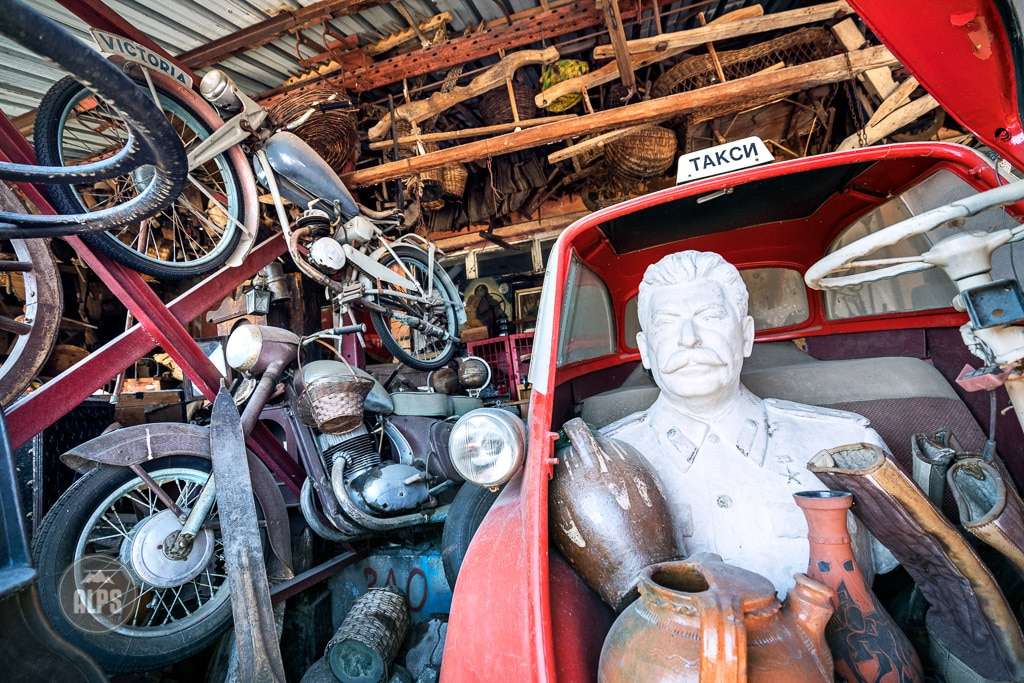An abstract still life of a bust of Stalin in an old car, Bulgaria