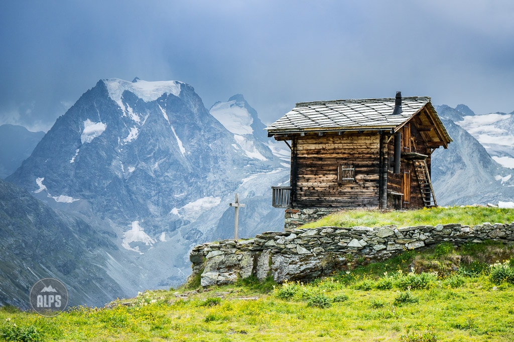 Classic Swiss house in mountain landscape