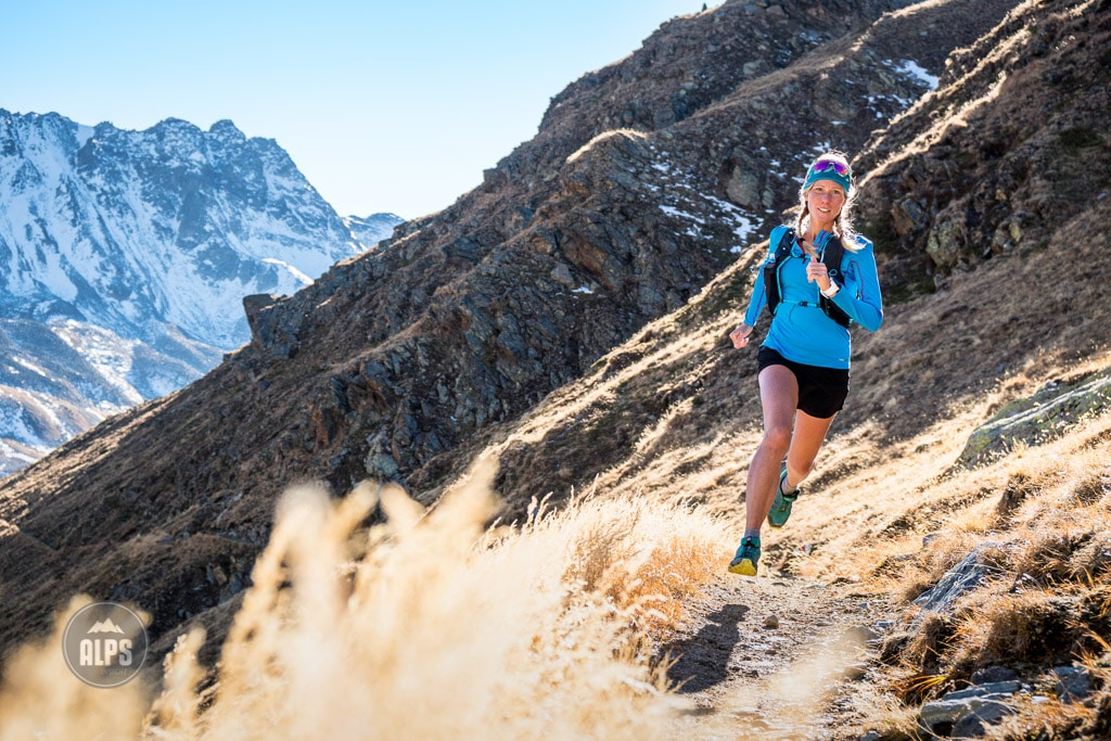Kim Strom Trail running above Val Funtauna between Berguns and Davos, Switzerland with golden fall colors