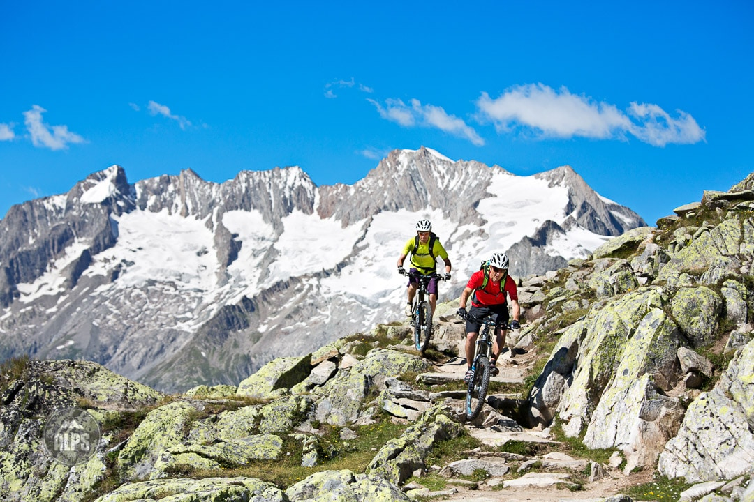 Mountain biking technical trails above the Aletschgletscher from Bettmeralp to Riederalp during the Swiss CrissCross project. Road ride through the Alps across Switzerland, then mountain bike back through the Alps on trails. 2012