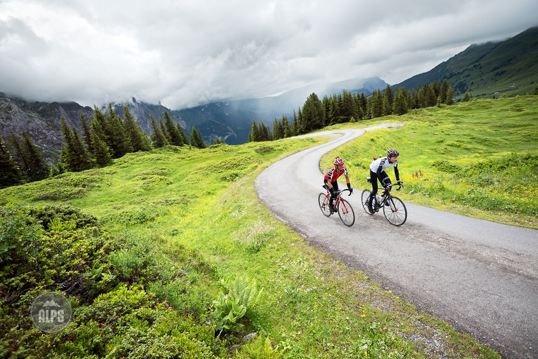 Road riders on the Grosse Scheidegg as rain begins to start. Day 2 of the Swiss CrissCross project. Road ride through the Alps across Switzerland, then mountain bike back through the Alps on trails. 2012