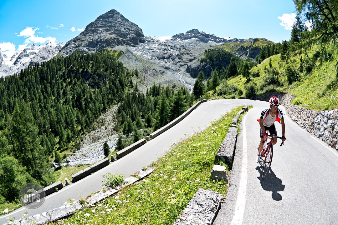Road biker climbing the Passo Stelvio on day 5 of the Swiss CrissCross project. Road ride through the Alps across Switzerland, then mountain bike back through the Alps on trails. 2012