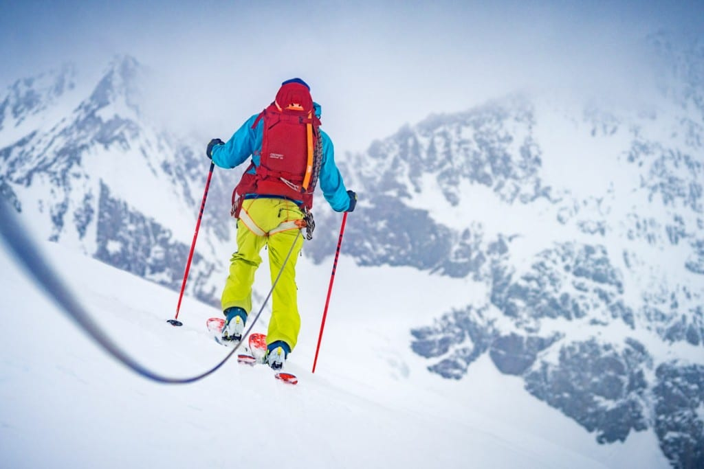 Ski touring on the Wysnollen using a rope because of poor visibility and crevasses, the peak is peak done during the Berner Oberland ski tour, near the Finsteraarhorn, Switzerland