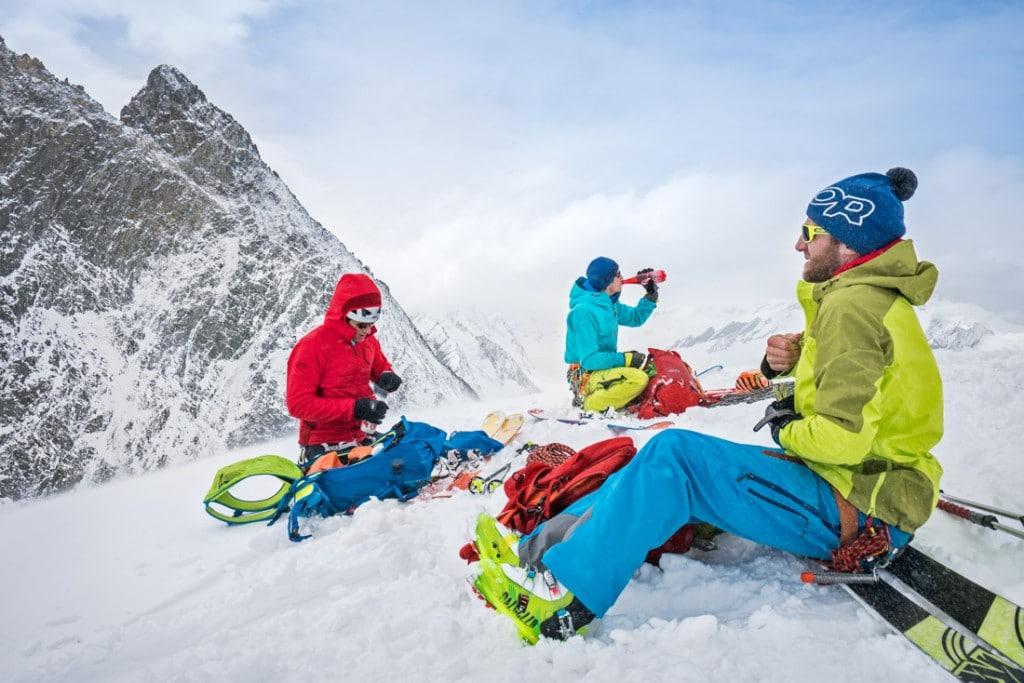 Ski tourers on the summit of the Wysnollen, a ski peak done during the Berner Oberland ski tour, Switzerland