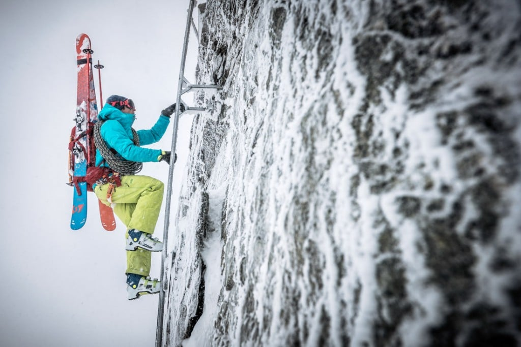 Climbing the ladders over iced up rock to the Oberaarjoch Hut in a freezing storm during a ski tour of the Berner Oberland, Switzerland.