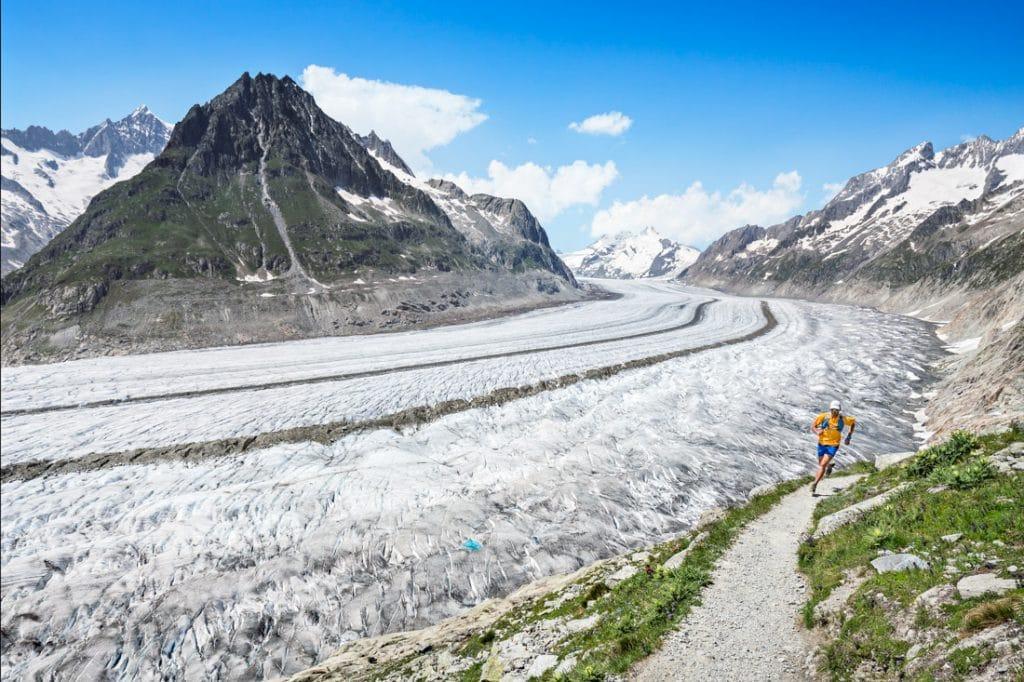 One man running singletrack trails above the Aletschgletscher, the Alps largest glacier and UNESCO site. Bettmeralp, Switzerland