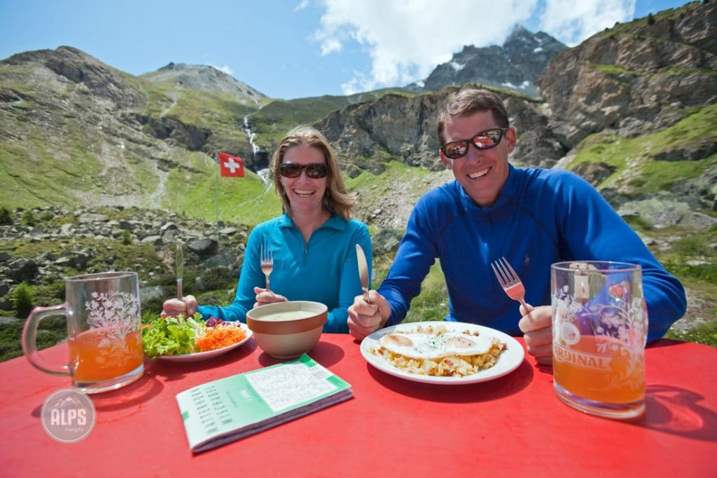 Couple eating lunch at the Swiss mountain hut, The Trift Hotel, above Zermatt