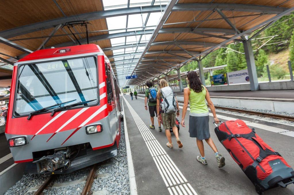 Travelers at a train station in Zermatt, Switzerland