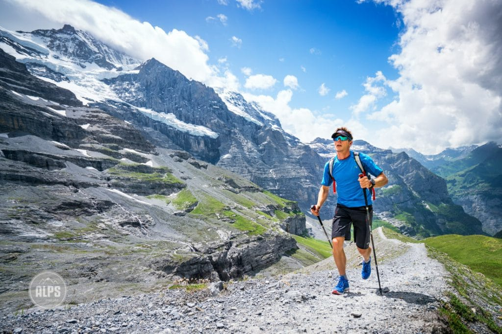 The German alpinist David Göttler trail running for training for his next expedition. Kleine Scheidegg, above Grindelwald and Lauterbrunnen, Switzerland