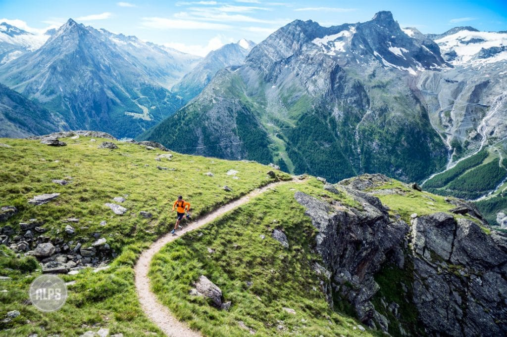 A trail runner on perfect singletrack above Saas Fee, Switzerland