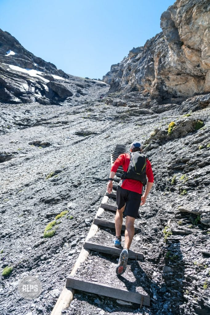 Trail running the Lauterbrunnen to Kandersteg tour, Switzerland. The trail up to the Bluemlisalp Hut is incredibly steep with long sections of steps in place to go straight up.