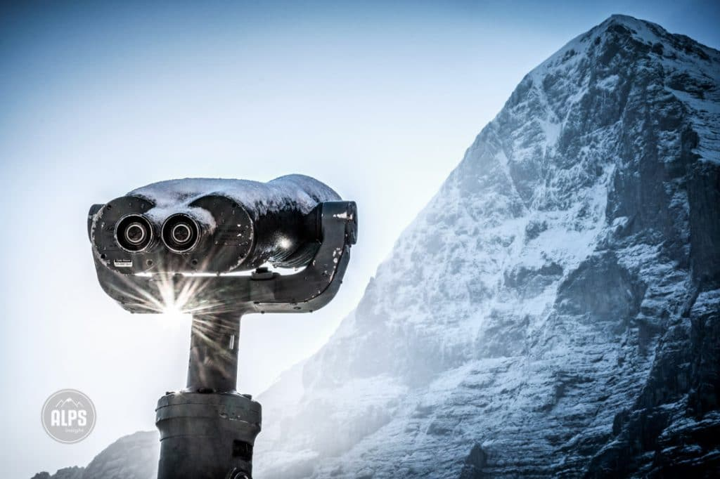 An old pair of binoculars mounted at Kleine Scheidegg point to the infamous north face of the Eiger. Grindelwald, Switzerland