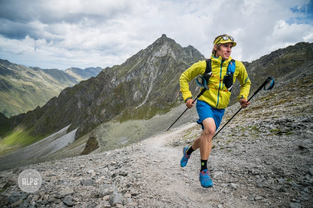 Trail running with poles above the Stubaital, Austria while on a multi-day running tour