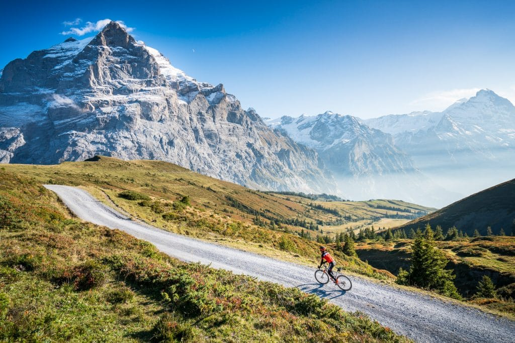 Gravel biking above Grindelwald, Switzerland with the Wetterhorn in the background.