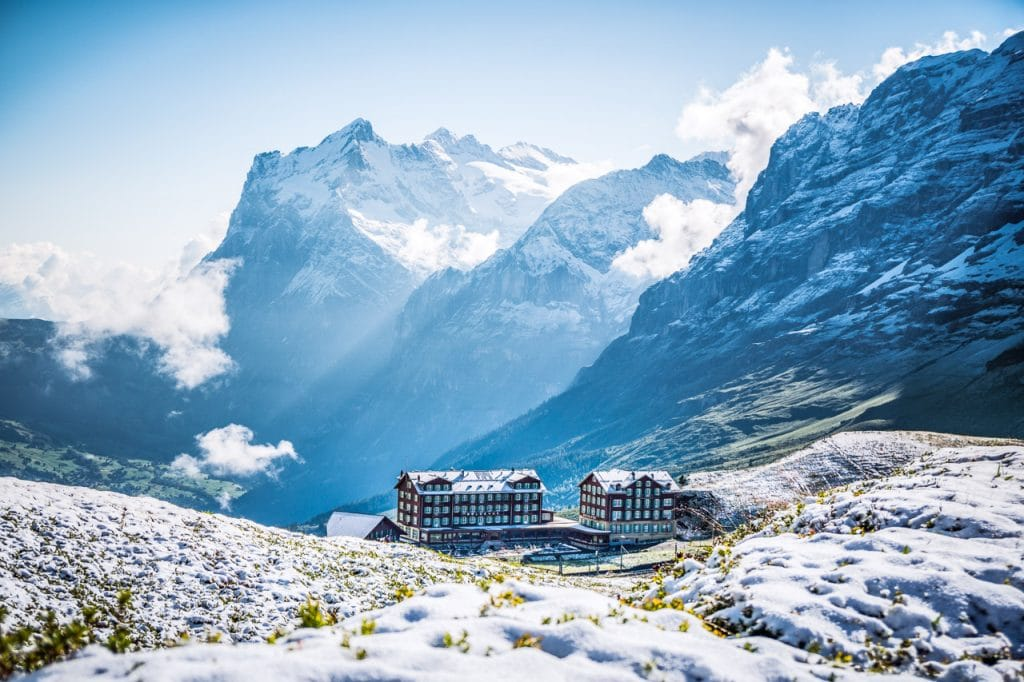 The Hotel Bellevue at Kleine Scheidegg on a snowy morning with the Wetterhorn in the background. Grindelwald, Switzerland