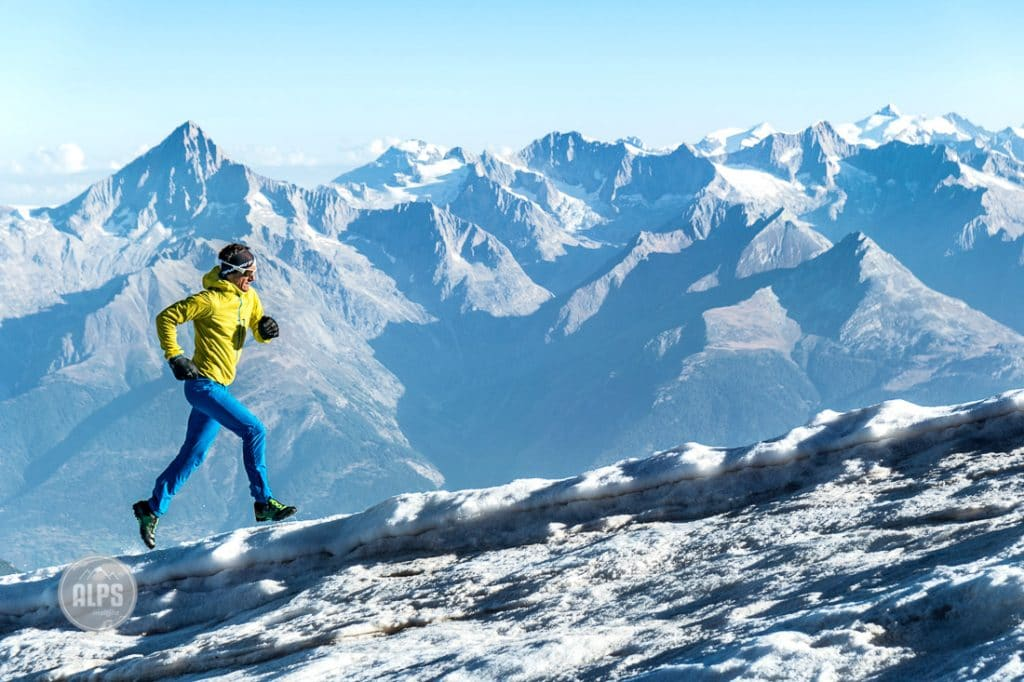 Mountain running on snow and glaciers on the Balfrin Traverse, a high ridge line between Grächen and Saas Fee, Switzerland