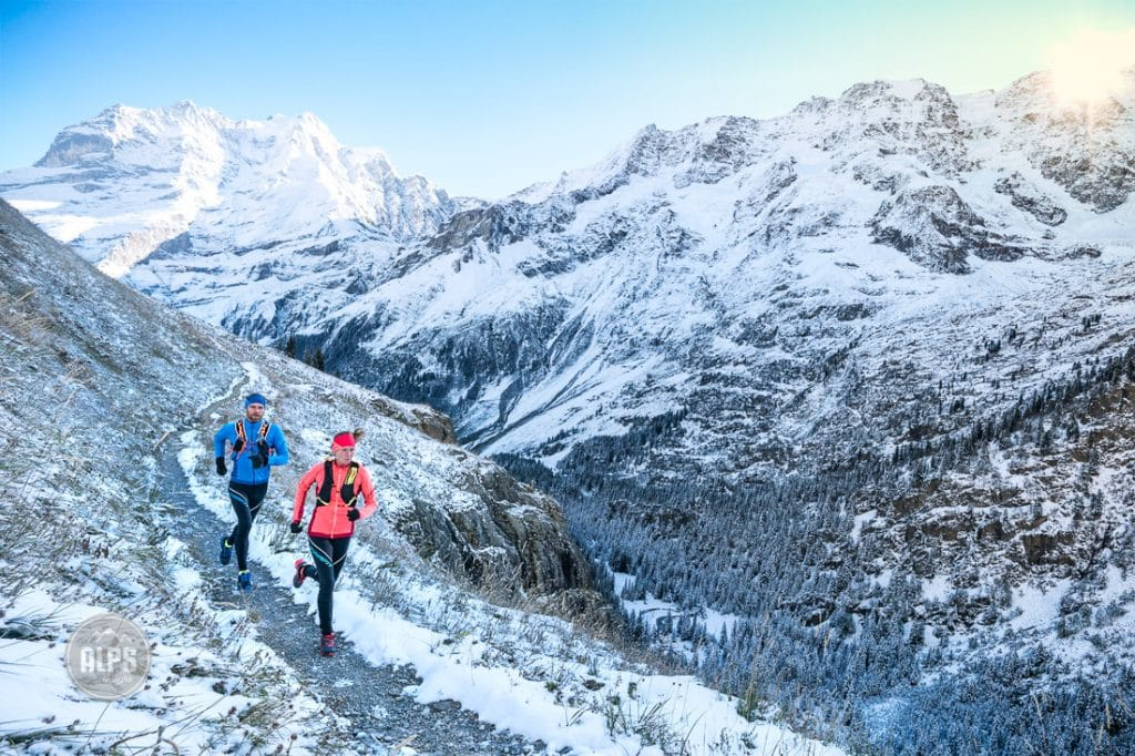 Trail running in early winter conditions above Lauterbrunnen Valley, Switzerland