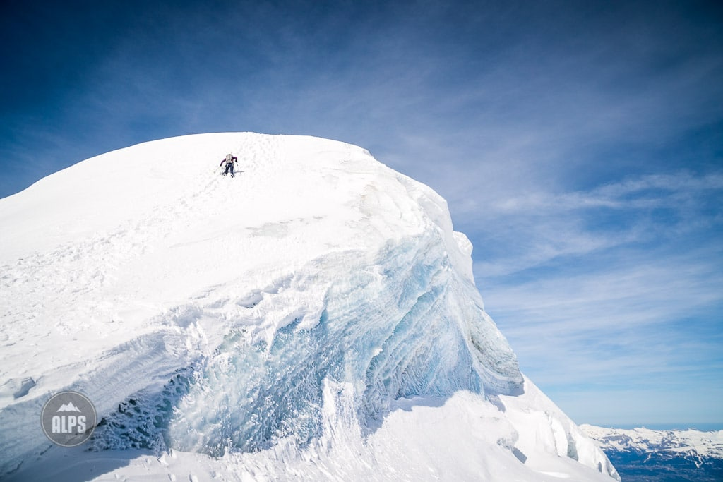 The last 30 meters of the Bishorn, 4153 meters, is the only steep section as it climbs an ice cap. Switzerland.