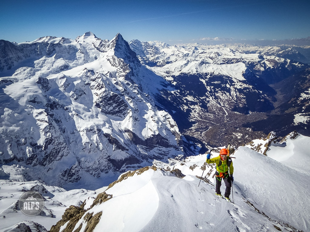 Dan pulling in to the summit of the Mittelhorn with the Eiger behind, and Grindelwald far below.